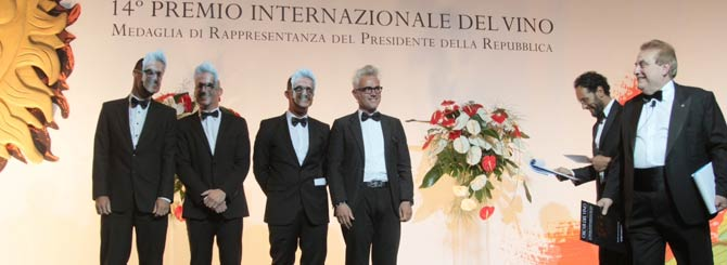 Masked pruners and Marco Simonit (4th L) about to receive an Oscar del Vino, Rome