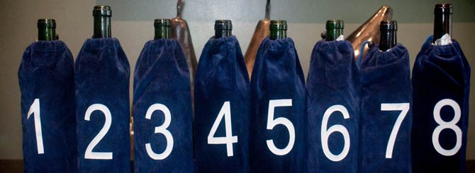 The bagged bottles lined up ready for the blind tasting