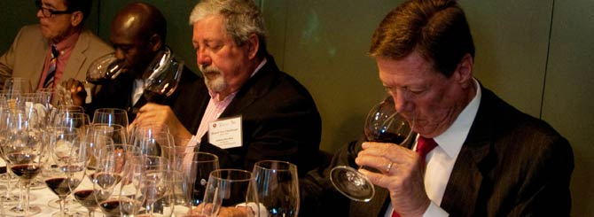 Aurelio Montes Snr. (R) at the tasting, alongside the judges