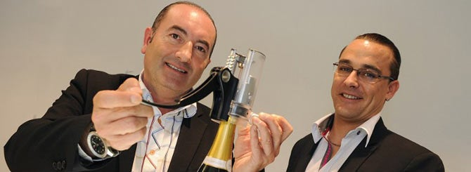 Jacques Pitoux (L) and Pierrick Duret show off their invention in Champagne